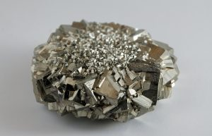 Metallic luster in gold-colored pyrite with observable cleavage.