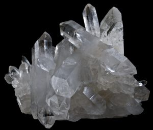 Non-metallic luster in prismatic quartz with six-sided euhedral crystal form.
