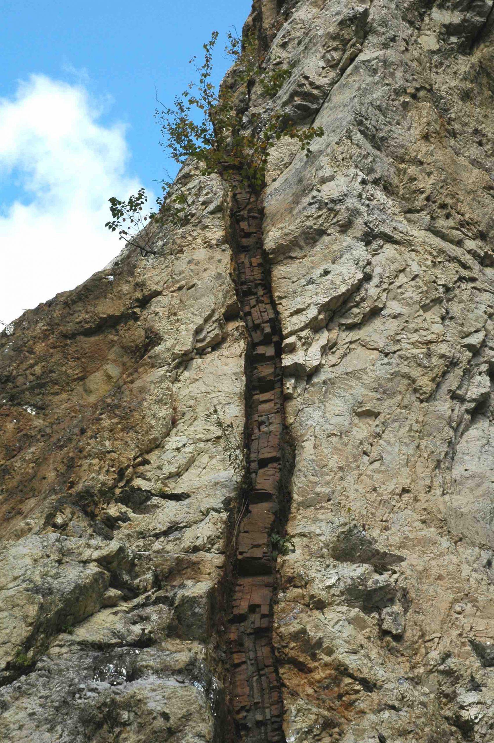 A mafic dike cutting through granitic pegmatite in Ruggle's Mine, New Hampshire.