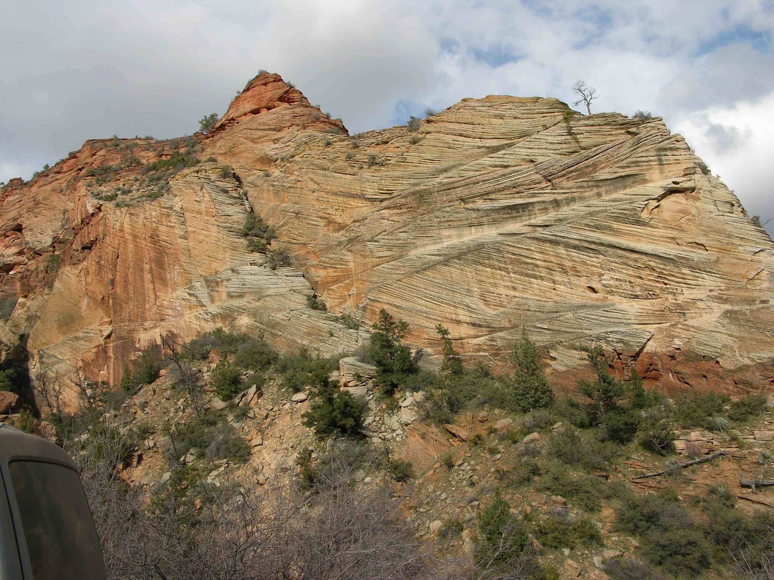 This image shows an example of cross-bedding, which looks like layers of sedimentary rocks dipping in different directions.